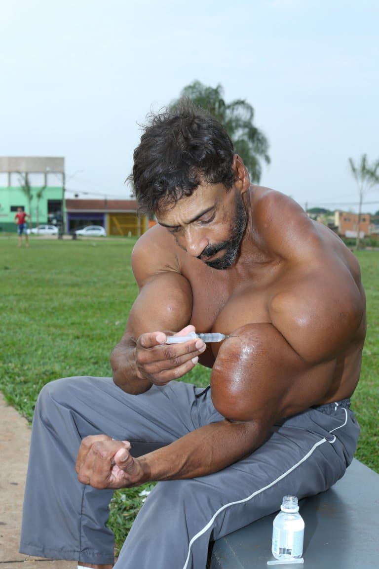 He injects synthol into his bicep (Picture: Barcroft)