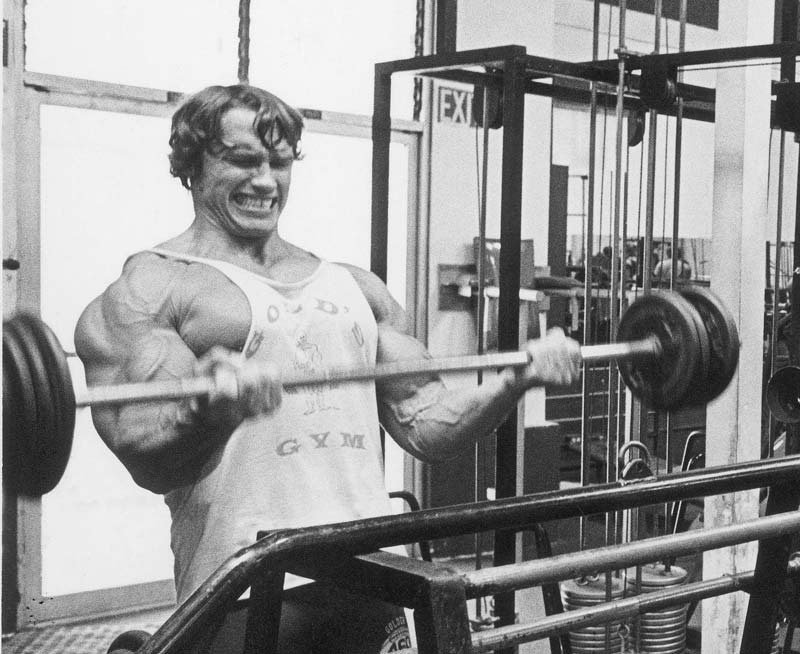 Arnold doing Curls