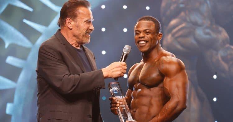 Men's Physique Winner Andre Ferguson With Gov Arnold Schwarzenegger