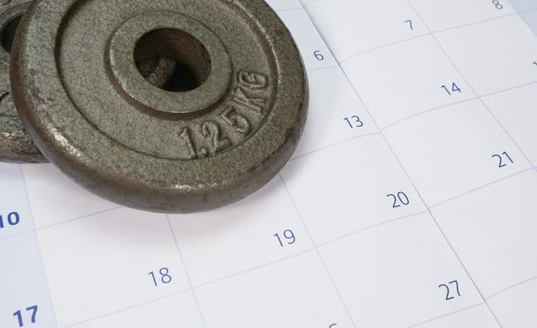 Two Weight Plates On A Calendar