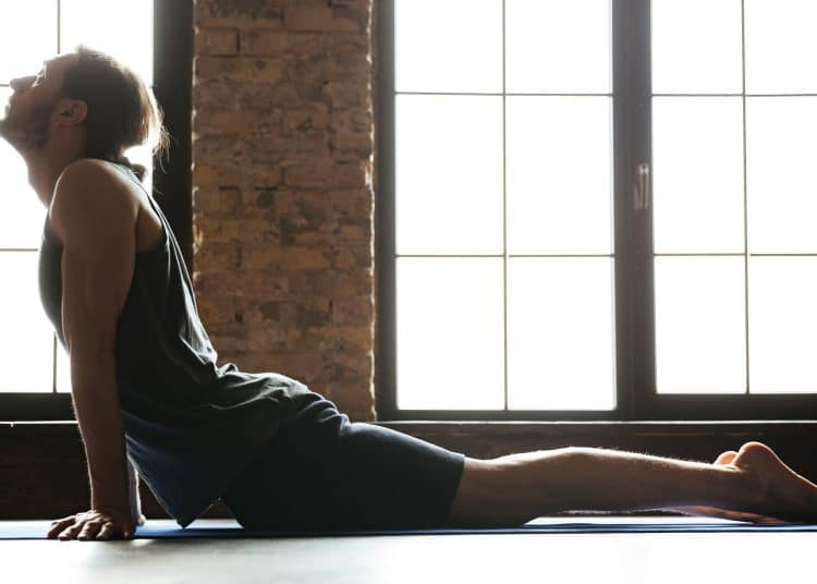 Young Concentrated Sportsman Stretching Muscles