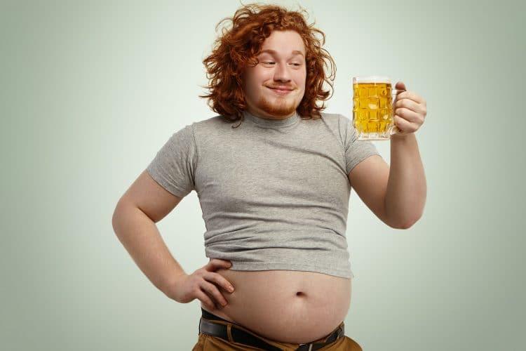 Overweight Man Drinking Beer