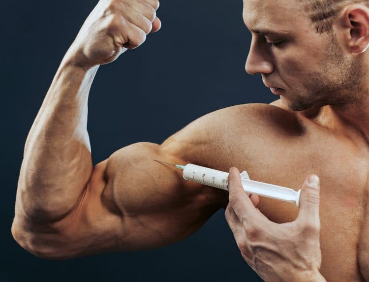 Bodybuilder Makes Injection