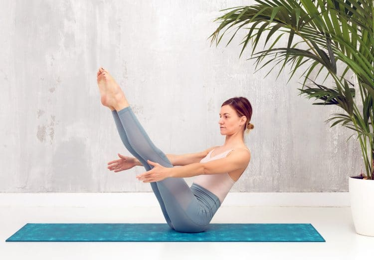 Navasana Yoga Pose or Boat Pose to Strengthen and Stretch The Spine